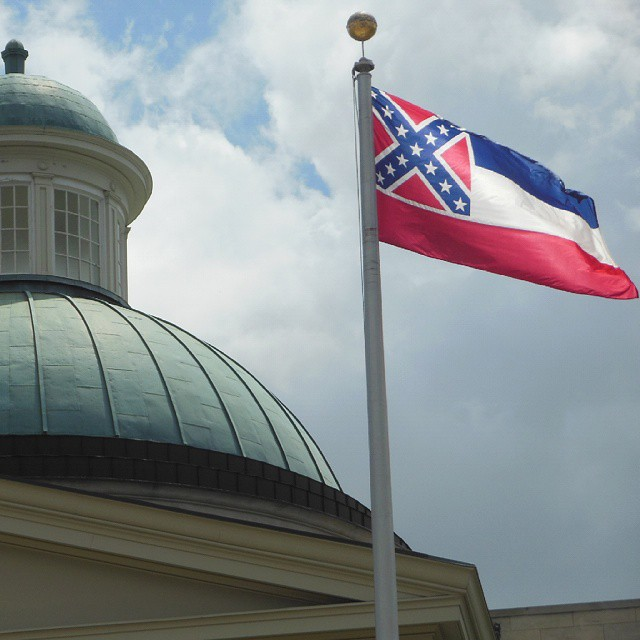 The currently very controversial Mississippi flag, pictured here flying over the Old Mississippi State Capitol Building.