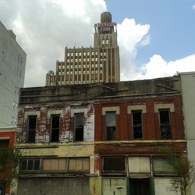 The Standard Life Building towers above disused stores in downtown Jackson, Mississippi.